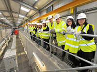 Romanian officials view the inside of the plant at Dunore Point