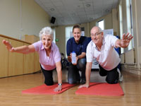 To mark Older People's Day on 1 October 2010, Iris Hill (Belvoir Park) and John Kitchen (Donegal Avenue) show Anna Marshall, NI Water's Education Officer, some keep fit moves.