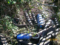 Photograph : Some of the rubbish removed from a sewer in Colinglen Park