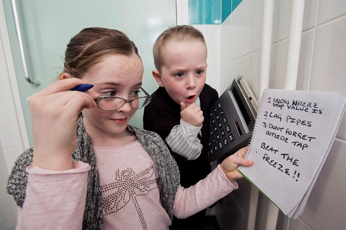 Lauren McCullagh (10) and Preston Parke (7) are shocked when they add up the cost of not protecting pipes in the home this winter.