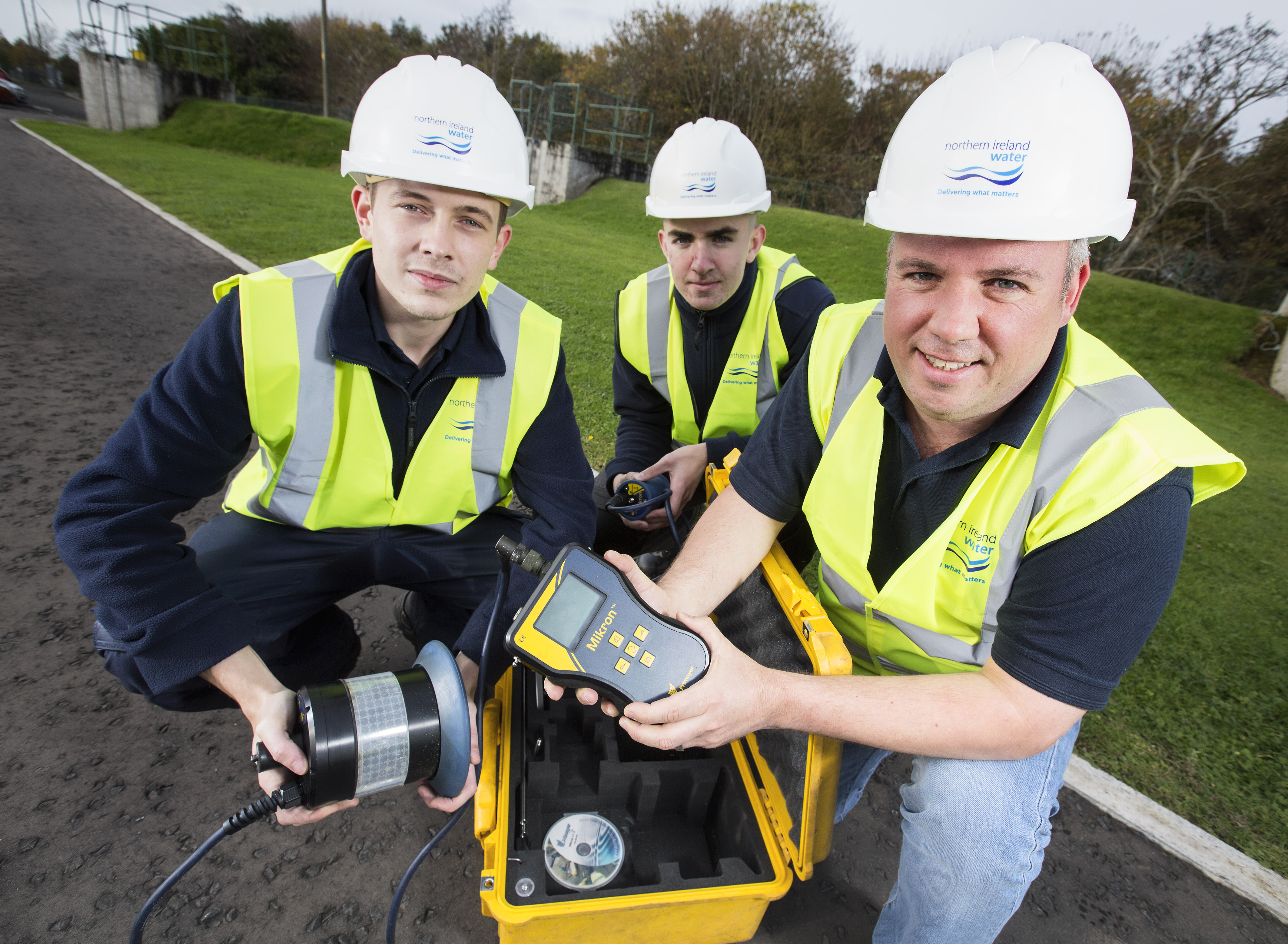 Chris Cole, Technical Learning and Development Advisor (right) shows Jack Reynolds (far left) and Toby Wright (left) how to search for leaks