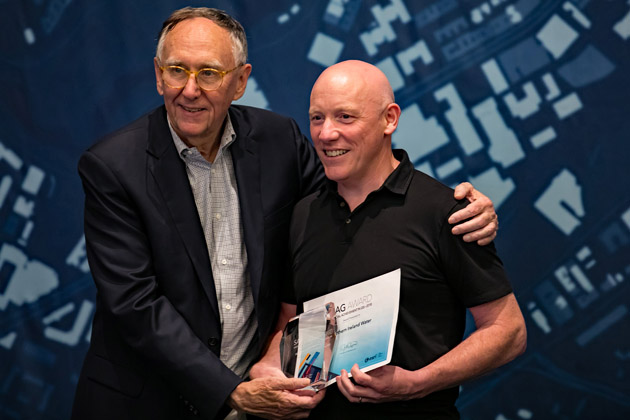 Sean O'Boyle ( NI Water Asset Information Development Manager) being presented with the award by Esri Inc President, Jack Dangermond.