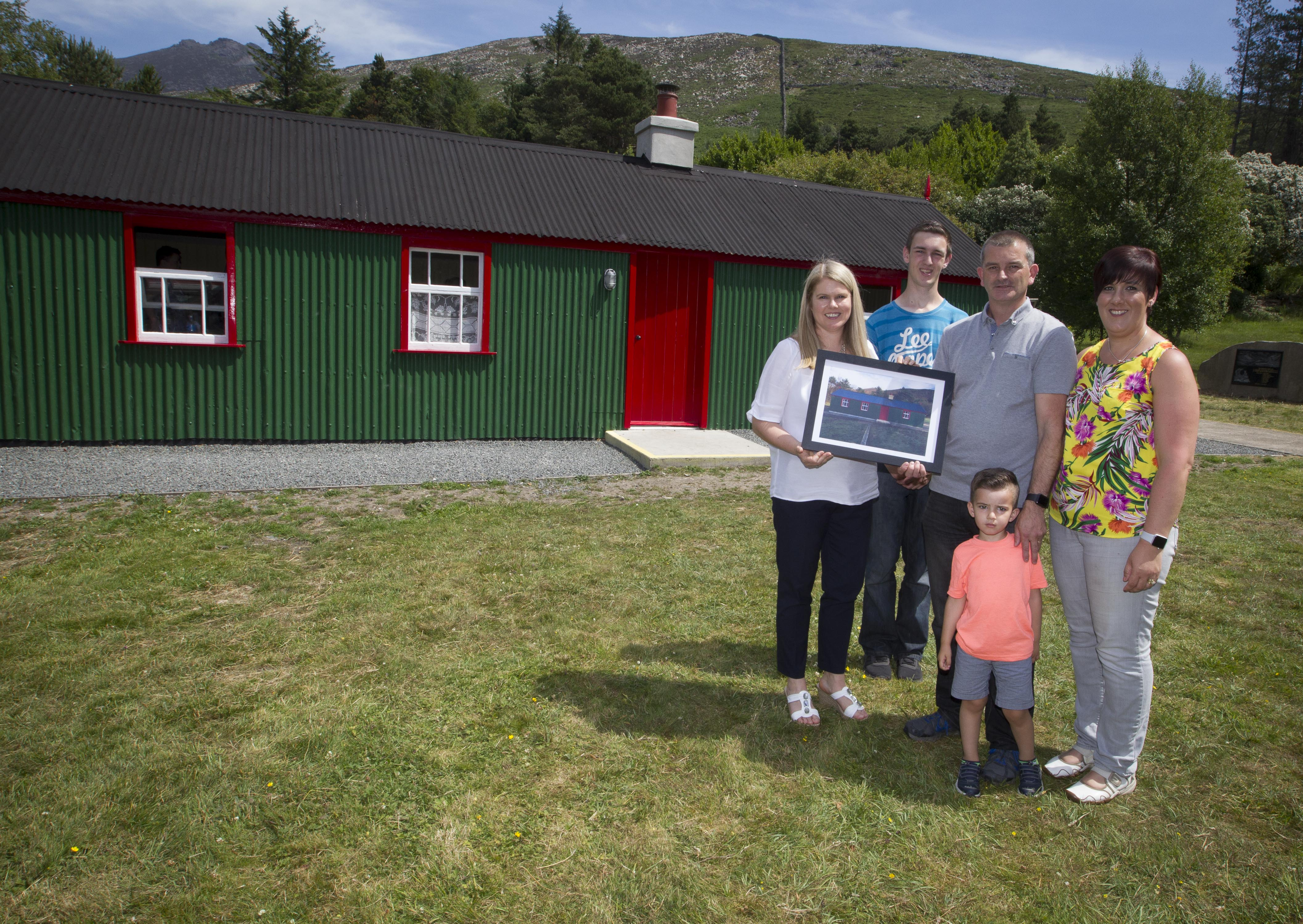 NI Water Chief Executive Sara Venning presents the Haugh family with a painting of Watertown House.