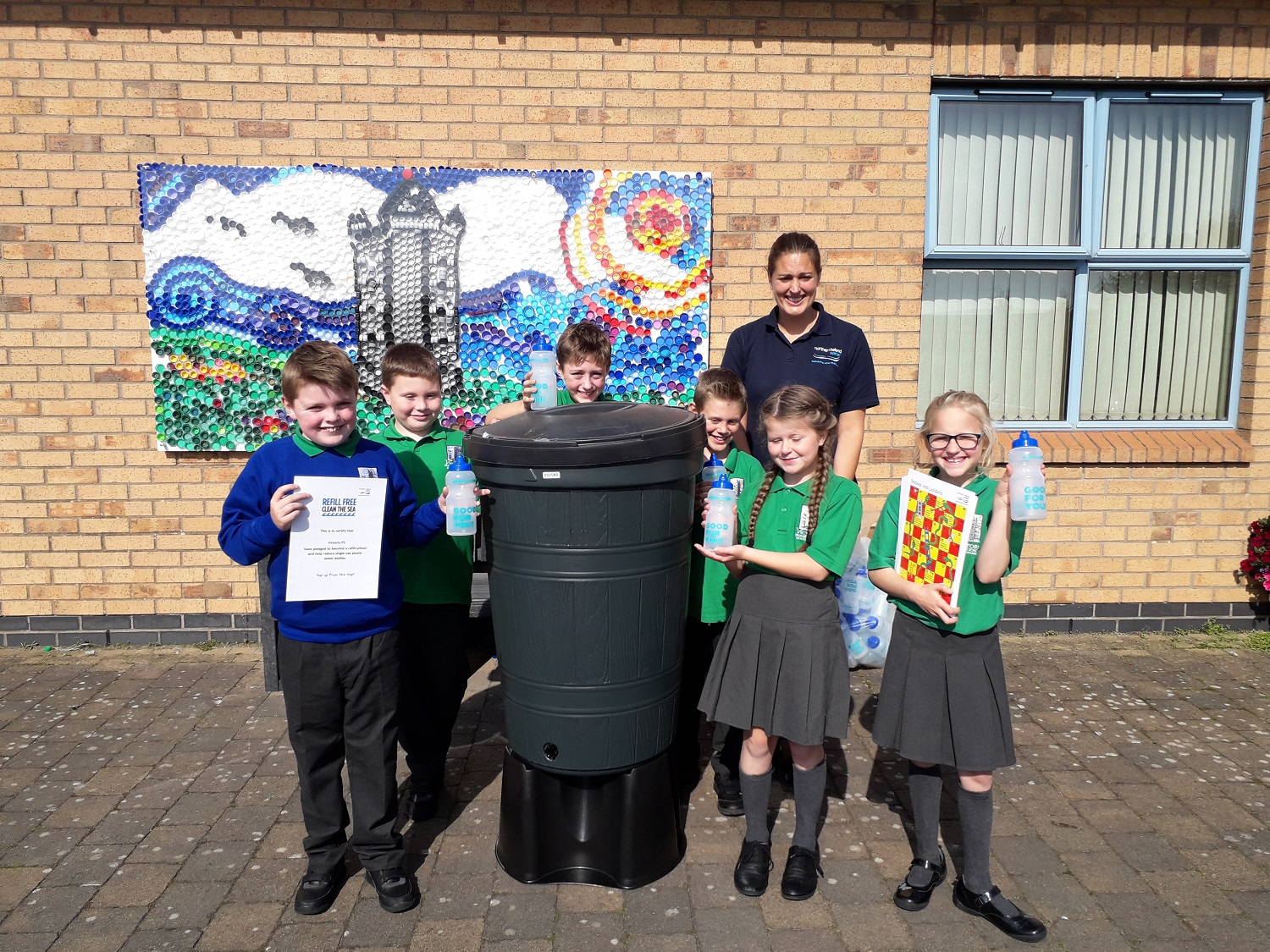 Pictured is NI Water Environmental Outreach and Learning Officer, Anna Killen, with pupils Victoria Primary School